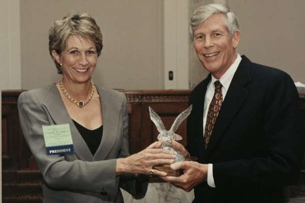 Connie Mack receiving a lifetime achievement award from the National Coalition for Cancer Research (NCCR)